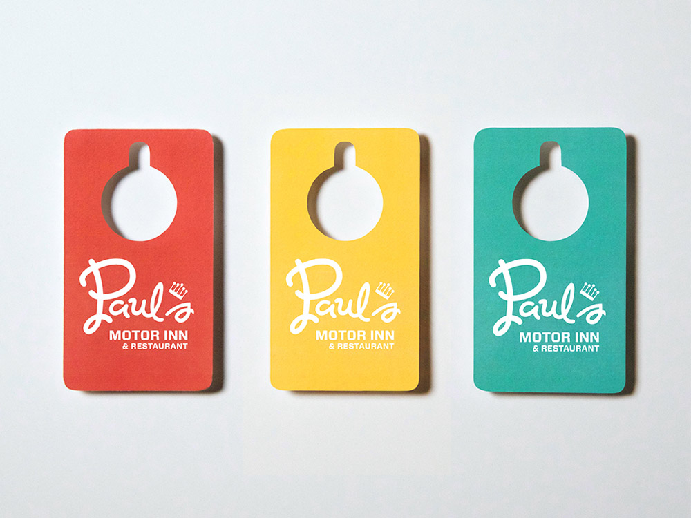 A collection of Paul's Motot Inn Business Cards
